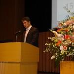 秋山信将大会実行委員長の総会での挨拶